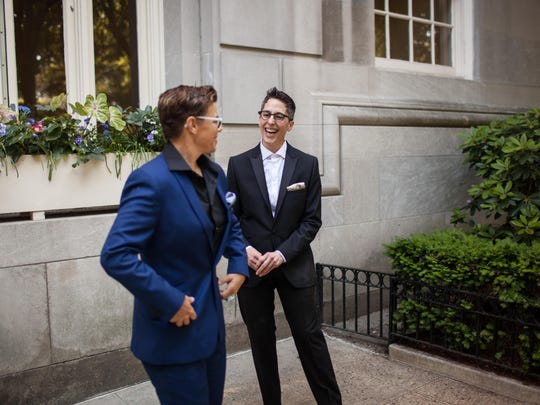 "Alison Bechdel of Bolton, Vt., author and illustrator of the memoir on which ""Fun Home"" is based, stands with her partner Holly Rae Taylor in front of the apartment where they were staying on the Upper East Side before driving to the Tony Awards in New York City on Sunday."
