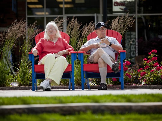 Mary Kelly and Donald Gildenpfennig relax at the Riverview Plaza courtyard in St. Clair.
