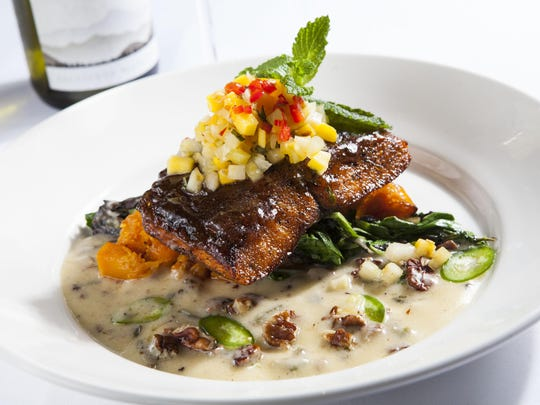 The blackened salmon is one of the early dining specials at Blue Water Bistro in Estero.