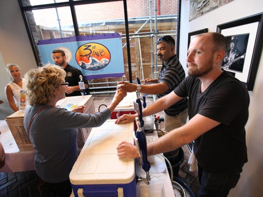3rd Wave Brewing Co. serves beer at Stone Balloon during the Downtown Newark Food and Brew Fest Saturday.
