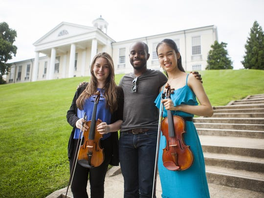 Noga Shaham, left, stands with Wynton Grant, center, and Liana Branscome, all full scholarship recipients at the 2015 Heifetz International Music Institute.
