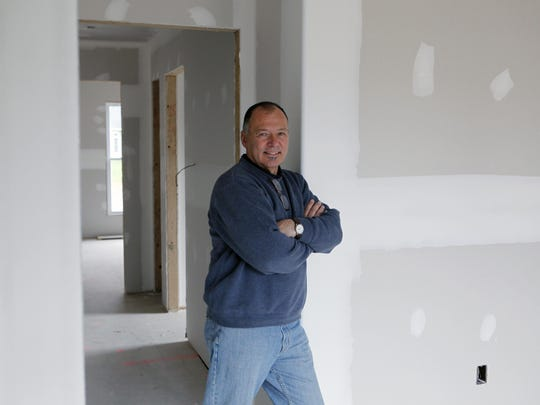 Lou Masi of Greece, a co-owner of Mascot Inc., stands in a home under construction by his company in November 2009.