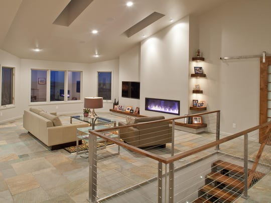 The relocated fireplace anchors contemporary light and a bright, open floorplan.