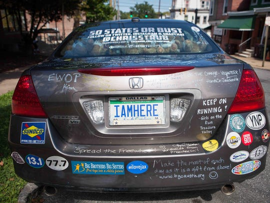 Messages from around the country adorn Chris Strub's Honda as he nears the end of a 50-state volunteering journey.