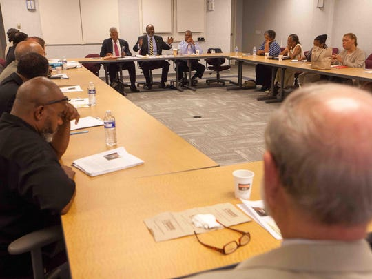 Delaware NAACP President Richard Smith (center) joins in a roundtable conversation with Hilary O. Shelton, director of the NAACP Washington Bureau and senior vice president for advocacy, as he makes a visit to Wilmington.
