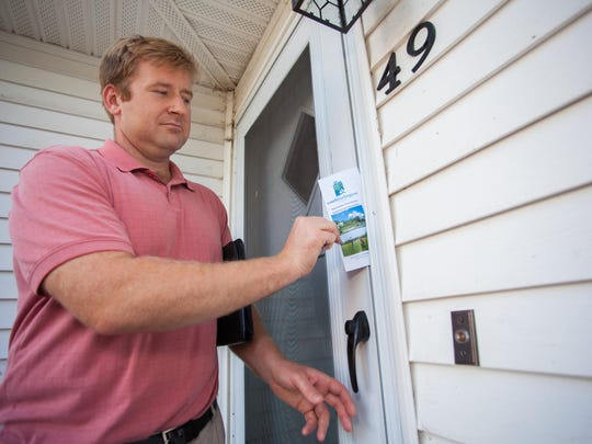 South Burlington City Council member Tom Chittenden leaves a flyer at a rented property on East Terrace with information about the city's noise policies.