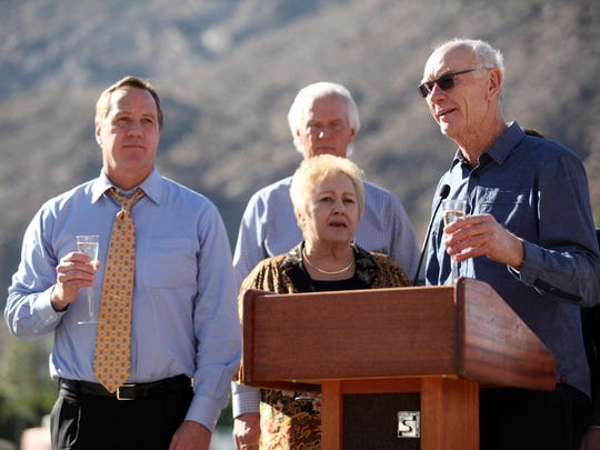 Developer John Wessman, right, participates in the groundbreaking ceremony for the Desert Fashion Plaza project on Jan. 16, 2014, in Palm Springs with Mayor Steve Pougnet, left, and council members Ginny Foat, front, and Chris Mills, back.
