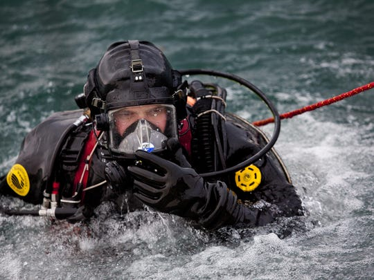 JEFFREY M. SMITH/TIMES HERALDSt. Clair County Sheriff Department dive team member Keith Kodet prepares to dive during a training session Saturday on the St. Clair River in Port Huron.