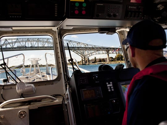 JEFFREY SMITH/TIMES HERALDU.S. Coast Guard coxswain David Olsgard looks out of the front of the cabin at the Blue Water Bridge while on patrol.