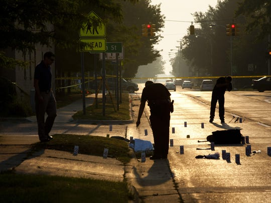 photos by JEFFREY M. SMITH/TIMES HERALDMembers of the Port Huron Police Department investigate the scene of a suspected hit-and-run Wednesday on Oak Street between 10th and and 11th Streets. Members of the Port Huron Police Department investigate the scene of a suspected hit-and-run Wednesday, September 2, 2015 on Oak Street between 10th and and 11th Streets in Port Huron. Police were called at about 6:30 a.m. to Oak Street for a report of a person by the roadway.