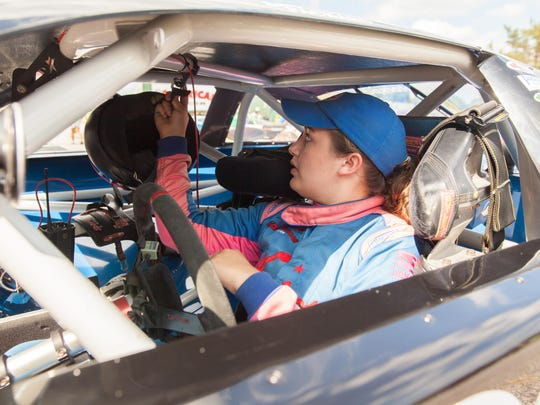 Emily Packard in her car for the the 37th annual Coca-Cola Labor Day Classic 200 at Thunder Road in Barre on Sept. 6.