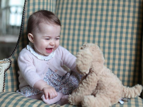 In this undated handout photo provided by HRH The Duchess of Cambridge, Princess Charlotte of Cambridge plays with a teddy as she is seen at Anmer Hall earlier this month taken by Catherine, Duchess of Cambridge in Sandringham, England.