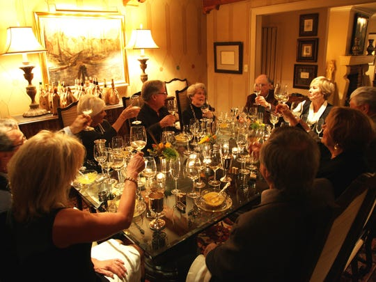 Friends raise their glasses in a toast to one another. Pictured from left, Donna Frankland, Bob Frankland, Alice Kirkland, Carl Kirkland, Patty Lewis, Don Lewis, Sally Rainey, Tom Rainey, Patsy Camp and Chuck Camp.