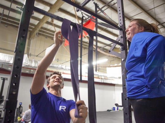 Tim Campanaro and Haley Dover prepare to do crossfit exercises Firday in Colchester.