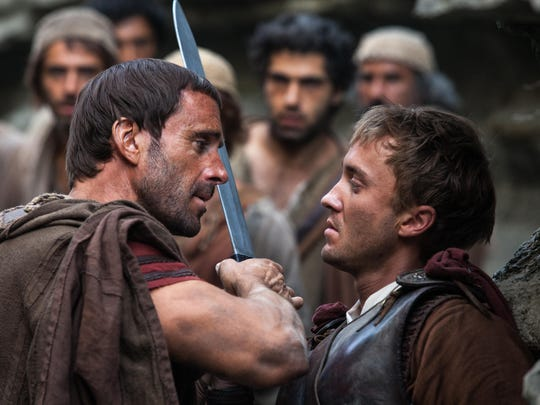 """Clavius (Joseph Fiennes, left) warns Lucius (Tom Felton) to let them all pass, after he discovers him leading the apostles away from the Roman soldiers in """"Risen."""""""