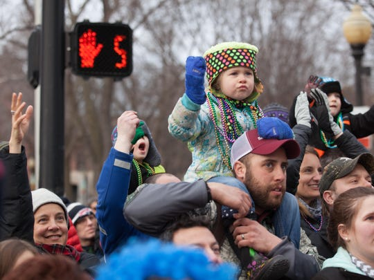 Colbie Curler, 4, sits on the shoulders of her dad, Bobby, for a view of the parade.