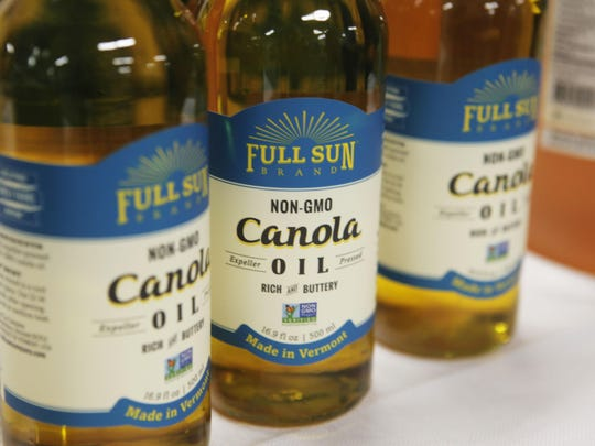 Bottles of non-GMO canola oil are sold at the 2016 Vermont Farm Expo on Jan. 27.