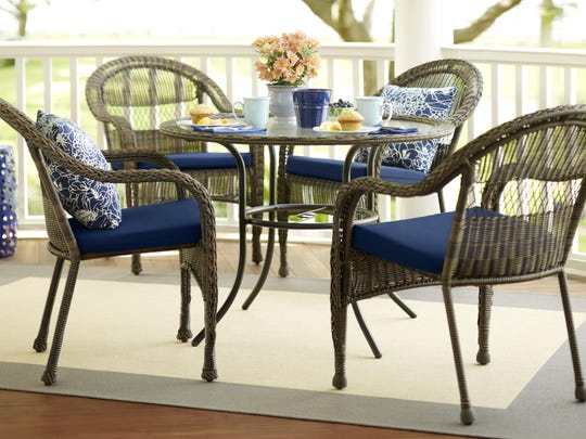 Add color to your outdoor patio with cushions.