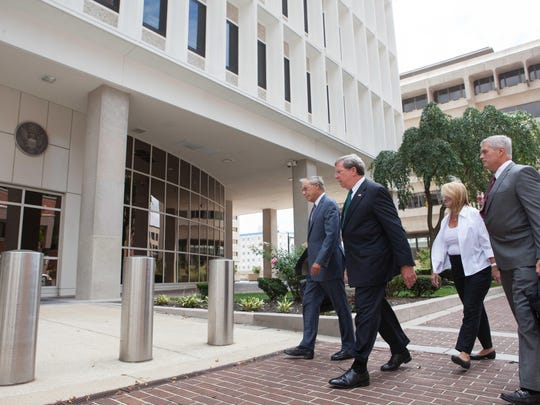 Former Wilmington Trust President Robert Harra Jr. (second from left) arrives at the federal courthouse in Wilmington in this file photo.