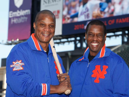 "FILE - This Aug. 1, 2010, file photo shows former New York Mets' players Dwight Gooden, right, and Darryl Strawberry posing at Citi Field in New York. Gooden has denied, Monday, Aug. 22, 2016, Darryl Strawberry's accusation that he is ""a complete junkie-addict,"" saying his former teammate is just taking it personally that Gooden could not make a scheduled public appearance with Strawberry last week. (AP Photo/Seth Wenig, File)"