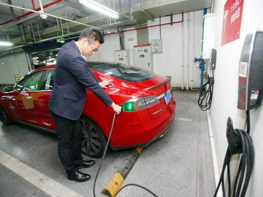 Tesla will modify new cars to match China charging standards