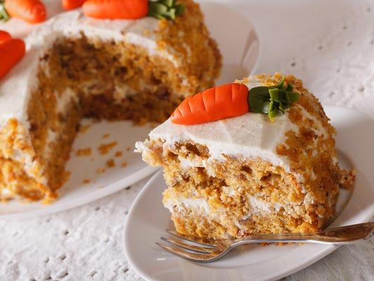 Sliced carrot cake on a plate closeup. horizontal