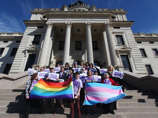 Representatives from the Center for Equality, American Civil Liberties Union of South Dakota, LGBT supporters and members of the Human Rights Campaign stand on the front steps in honor of Trans Kids Support Visibility Day at the State Capitol in Pierre on Tuesday, Feb. 23, 2016.