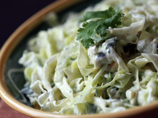 Quick and tangy, this Creamy Cilantro Slaw takes only 15 minutes to make.