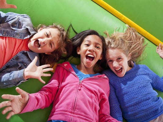 Girls lying down in bounce house