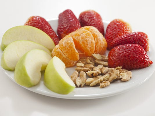 Healthy fruit snacks on a white plate