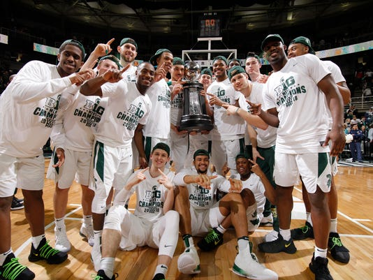 Michigan State players pose with thei Big Ten championship trophy following an NCAA college basketball game against Illinois, Tuesday, Feb. 20, 2018, in East Lansing, Mich. Michigan State won 81-61 to clinch at least a share of the title. (AP Photo/Al Goldis)
