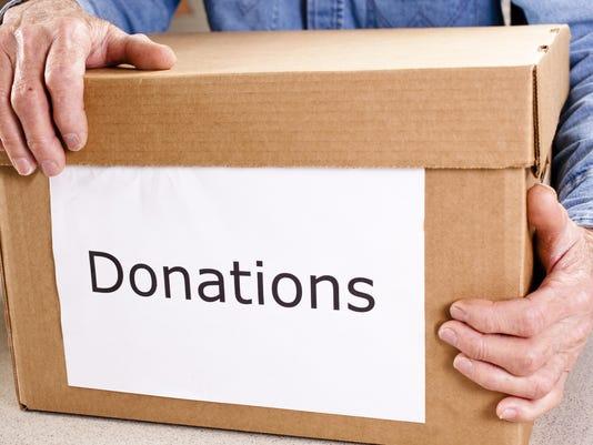 Volunteerism: Senior adult man delivers donations box.