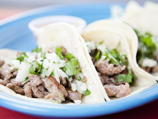 Mexican food: three gourmet steak tacos