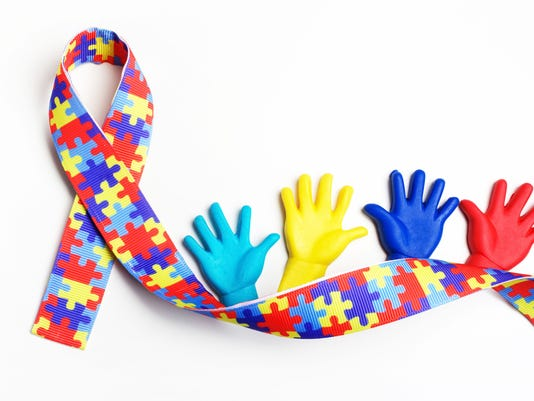 Autism awareness concept with colorful hands on white background. Top view