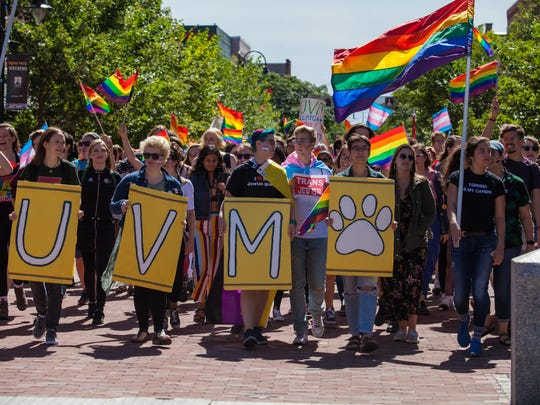 Members and staff of newly named Prism Center at the University of Vermont make their way up Church Street.
