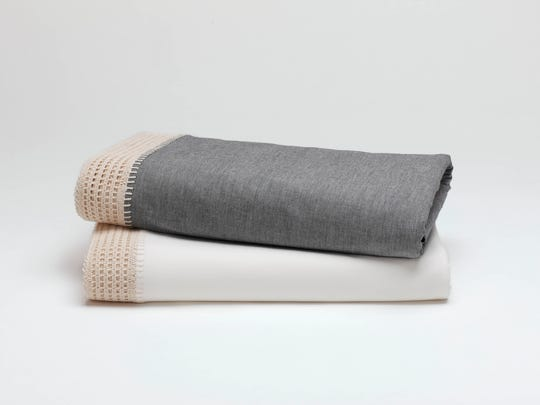 Crochet-trimmed sheets add texture and comfort to your winter bedding collection.