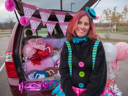 Angela Ross of Grand Isle poses in front her Candy