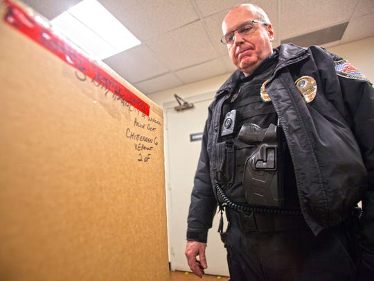 Lt. Scott McGivern of the Winooski Police Department shows how drug boxes are secured and stored. All pharmaceuticals collected in the pill drop box are boxed, labeled, and sealed with evidence tape. The boxes are stored in the Winooski Police evidence locker until transferred to the Drug Enforcement Administration.