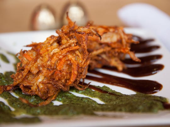 Vegatable Pakora at the Sherpa Kitchen,, deep fried, and served with a tamarind sauce and mint chutney.