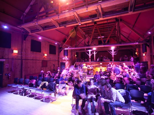 The audience moves around the newly renovated Haybarn