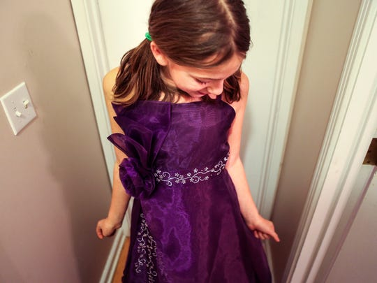 """""""She has her very first beautiful formal dress and I will probably buy her one every year,"""" said Chasilee Crawford about her daughter Zay's Christmas gift. """"Every little girl needs a formal dress in their closet. I probably had four in my closet when I was a little girl."""" The Enquirer/Meg Vogel"""