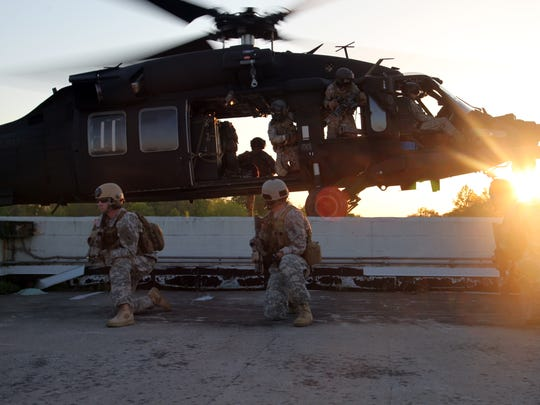 Soldiers from 5th Special Forces Group (Airborne) and 160th Special Operations Aviation Regiment (Airborne), conduct urban infiltration training in April 2013 at Fort Campbell, Ky.