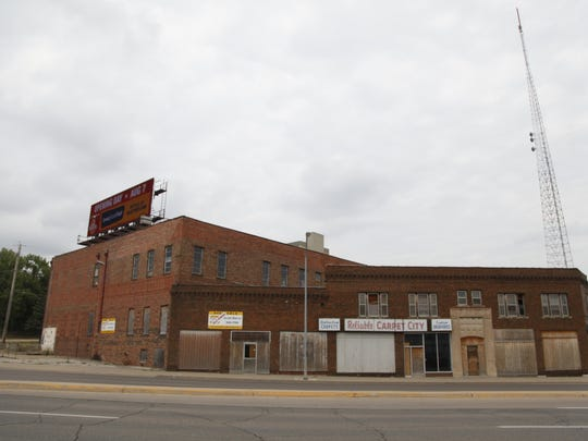 A local partnerships hopes to redevelop the former Reliable Carpet Co. buildings at 1201 and 1207 Keo Way. They're one of the last remaining vacant buildings on the entry into downtown.