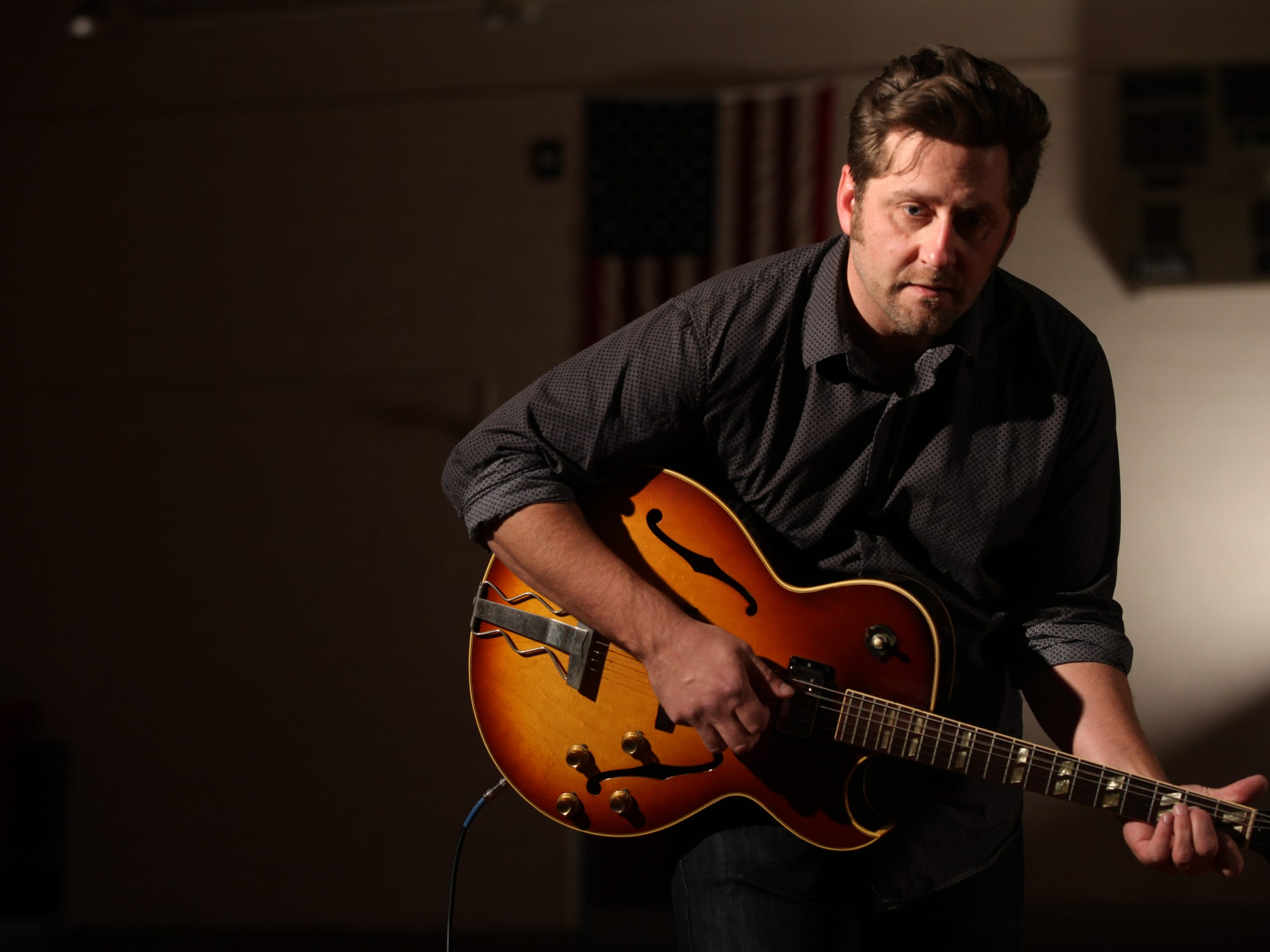 """Musician Chad Elliott performs """"Within These Walls"""" on Dec. 16 at Corwith-Wesley-Lu Verne High School in Corwith."""