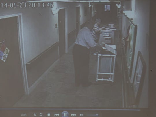 This still photo, taken from a video from security cameras at the Concord Care Center in Garner, shows Rayhons dropping his wife's underwear in a laundry cart after leaving her room last May 23. Prosecutors allege he was trying to hide evidence that he'd just had sex with his wife, but the defense lawyer has said Henry Rayhons often placed his wife's dirty laundry in the hamper.