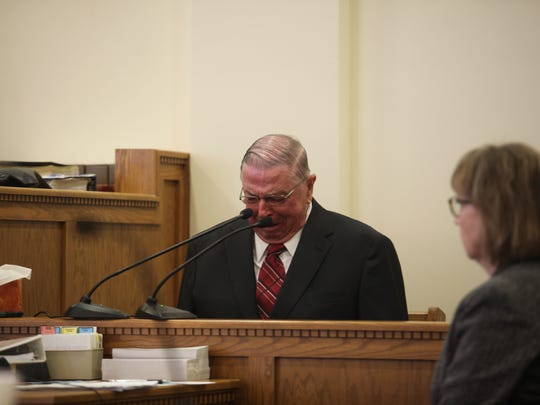 Henry Rayhons cries on the witness stand Friday during testimony at his trial. The former lawmaker is accused of taking advantage of his wife, Donna.