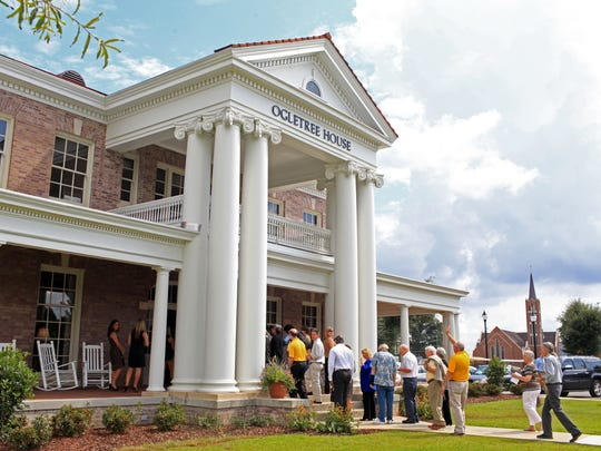 Event-goers line up to view the fully restored Ogletree House during the Ogletree House Grand Reopening and Landscape Restoration Project Celebration Ceremony at the University of Southern Mississippi. The historic Ogletree House sustained heavy damage from the EF4 tornado that hit Hattiesburg on Feb. 10, 2013.