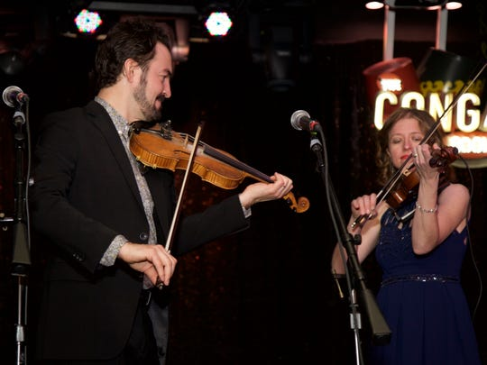 Magnolia Sisters member Anya Burgess plays with fiddle-playing, record producer Joel Savoy of Eunice at the Only in Louisiana luncheon at the Conga Room on the eve of the Grammy Awards.