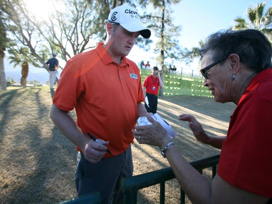 Jason Kokrak signs an autograph during the 2013 Humana Challenge. He is one of the tallest golfers in the field this week.
