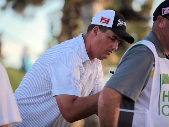 Michael Putnam autographs a caddy's jersey after finishing round 1 on the Jack Nicklaus Private Course on Thursday, January 22, 2015 at the Humana Challenge in La Quinta. Putnam leads by a shot after the first round.